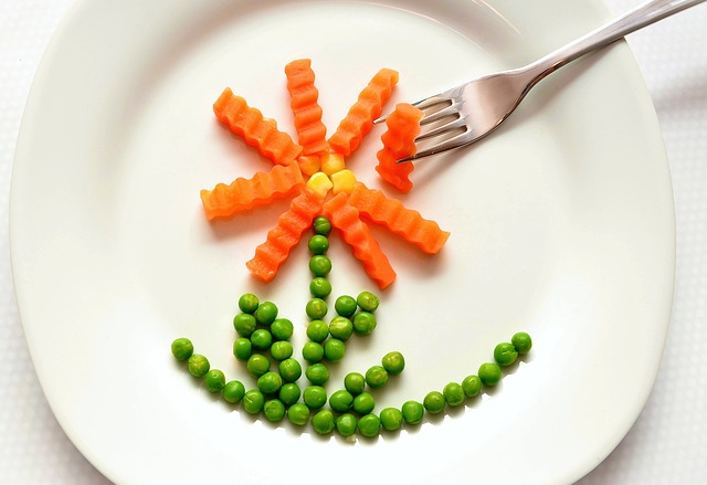 Plate of healthy food arranged in a flower to promote healthy eating
