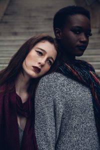 A woman leaning her head on her friend's shoulder. Shown to promote compassion and support between friends.