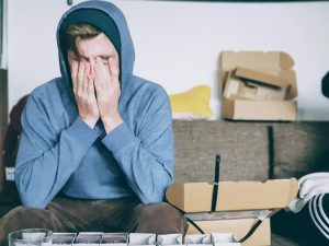 Image of young man looking stressed out to show that we all feel overwhelmed at times